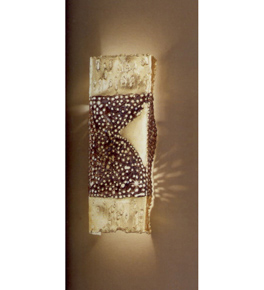 Forme design square metal wall light that has drill & flame cut centre details