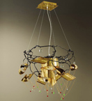 Spirale design forged metal chandelier with blown coloured glass details